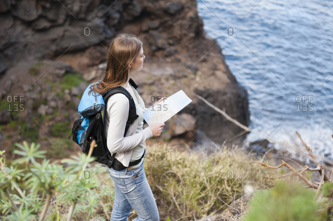 Female hiker with map on viewpoint- Tenerife- Balearic Islands- Spain