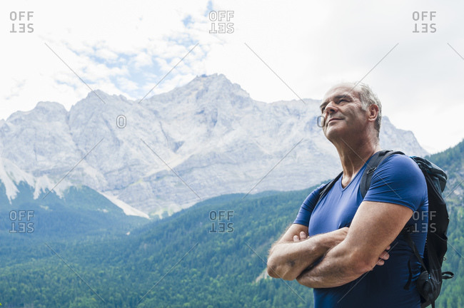 Senior man enjoying view after hike
