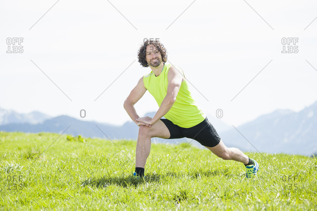 Jogger stretching his leg- Wallberg- Bavaria- Germany