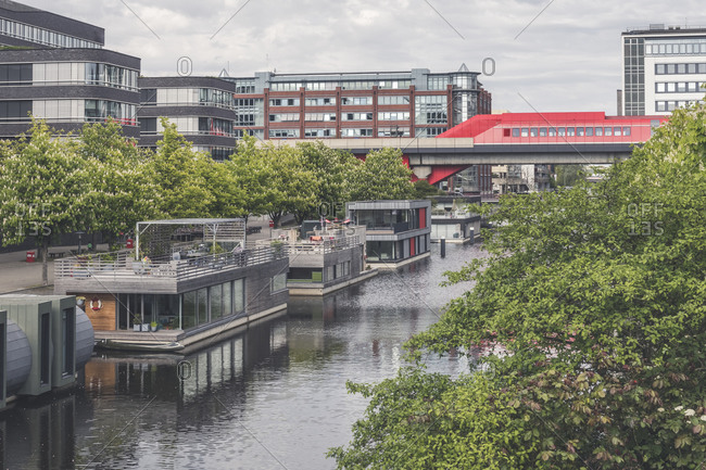 Germany- Hamburg- Houseboats along Mittelkanal with Hammerbrook Station in background