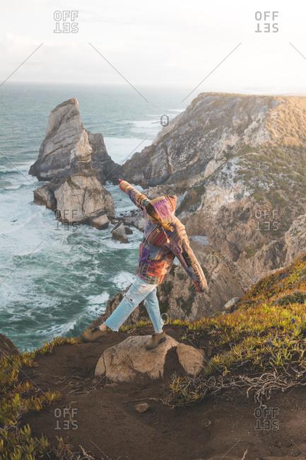 Full length of young woman balancing on rock at Ursa Beach- Lisboa Region- Portugal