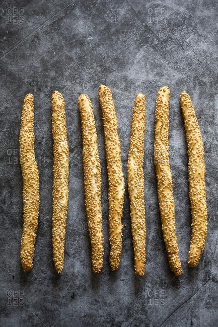 Studio shot ofItalian grissini breadsticks with sesame seeds