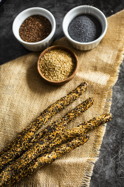 Place mat and fresh Italian grissini breadsticks with sesame- flax and poppy seeds