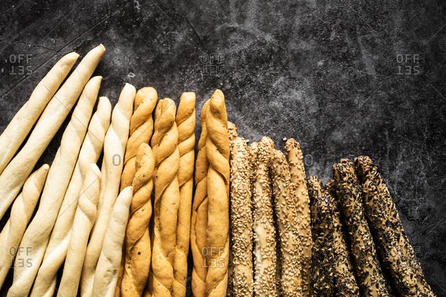 Studio shot of four different kinds of Italian grissini breadsticks