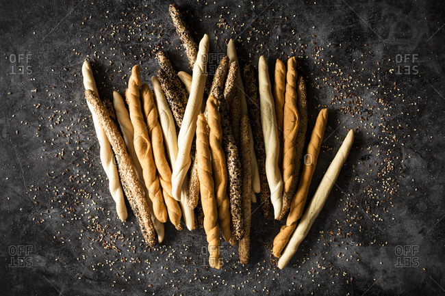 Studio shot of four different kinds of Italiangrissinibreadsticks