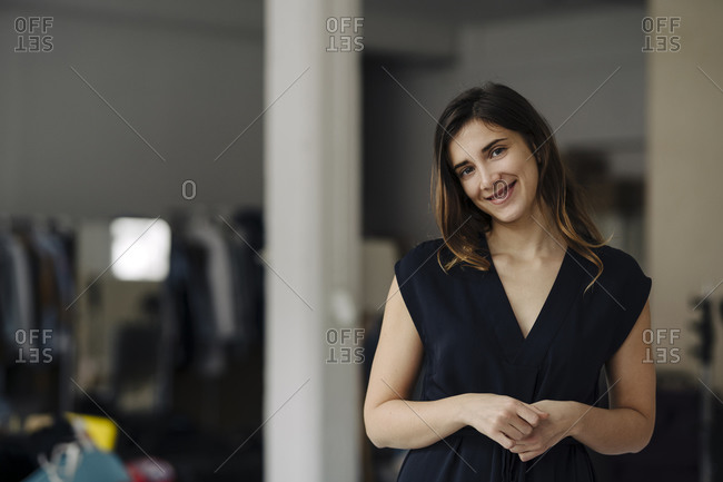 Portrait of smiling young businesswoman in a loft