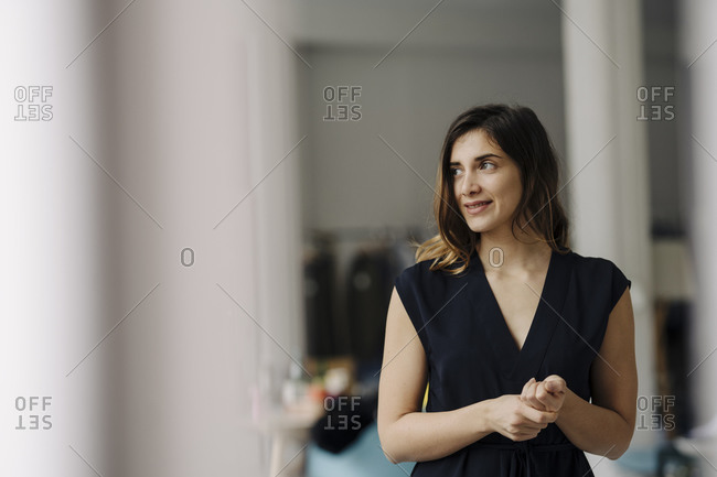 Portrait of smiling young businesswoman looking at distance