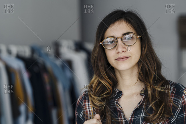 Portrait of young fashion designer in a loft