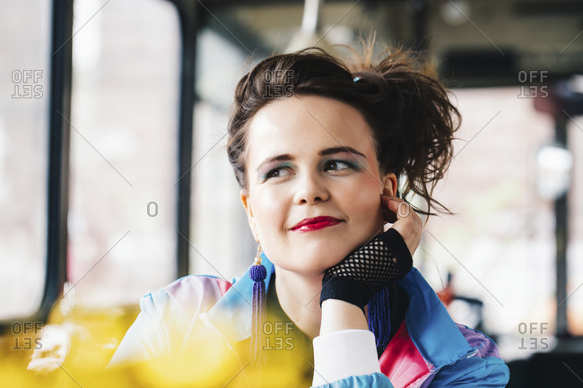 1980s retro-styled woman sitting in an old bus