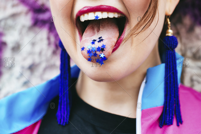 1980s retro-styled woman with stars on tongue