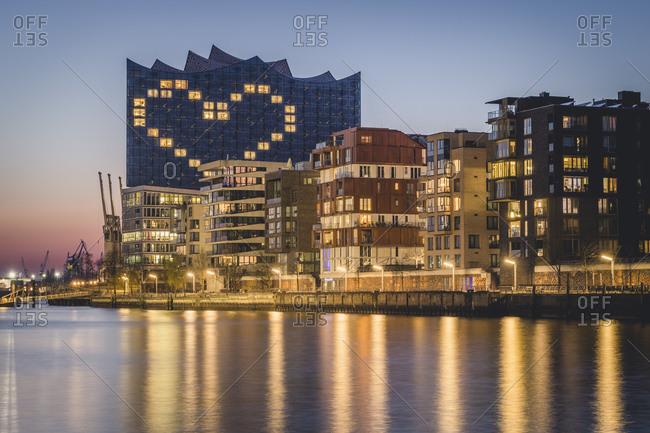 March 26,  2020: Germany- Hamburg- Heart shape displayed on Elbphilharmonie at dusk