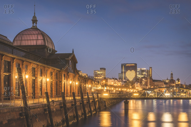 April 3,  2020: Germany- Hamburg- Illuminated Saint Pauli Piers fish market at dusk