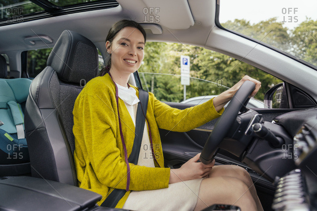 Portrait of smiling car driver with protective mask