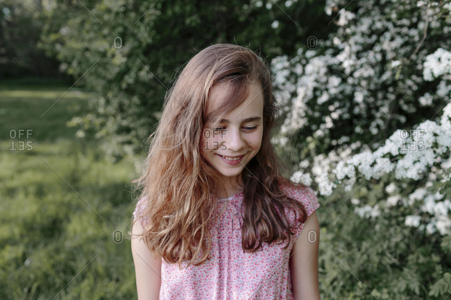 Portrait of a smiling girl in nature