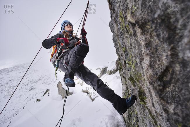 Mature woman climbing at Grossvendediger- Tyrol- Austria