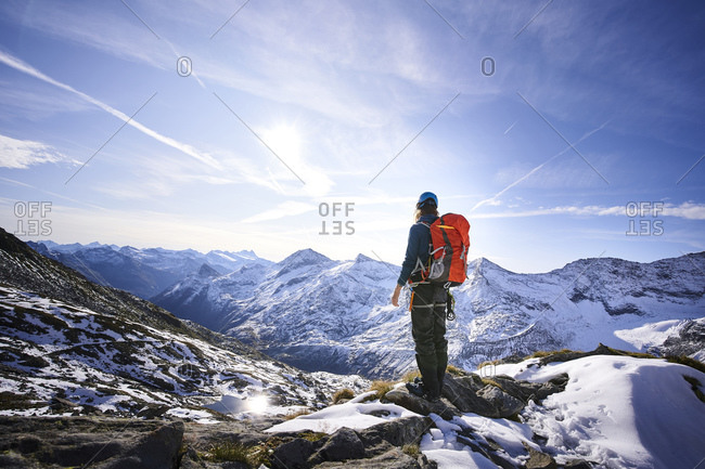 Female mountaineer with backpack on viewpoint- Glacier Grossvendediger- Tyrol- Austria