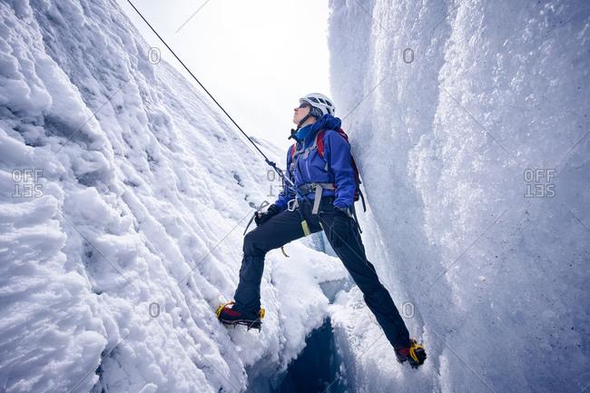 Female mountaineer in crevasse- Glacier Grossvendediger- Tyrol- Austria