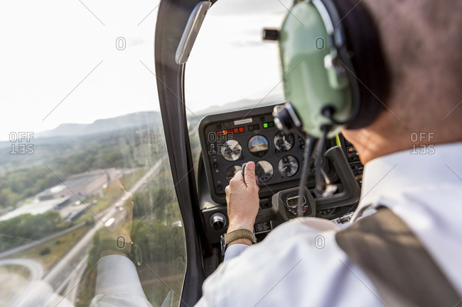 Pilot flying in sports plane- VFR chart on his lap