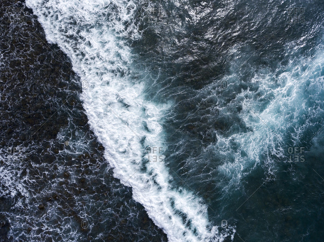 Aerial view of fierce ocean waves during a storm