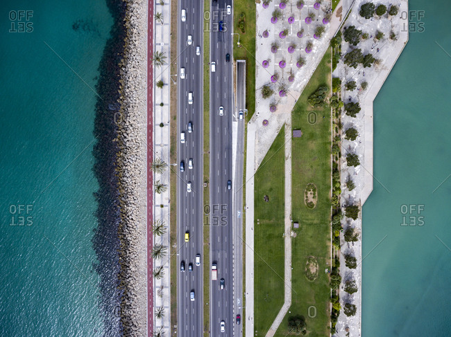 Aerial view of a six lane highway by the sea