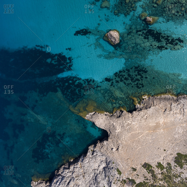 Birds eye view of rocky coast and turquoise waters