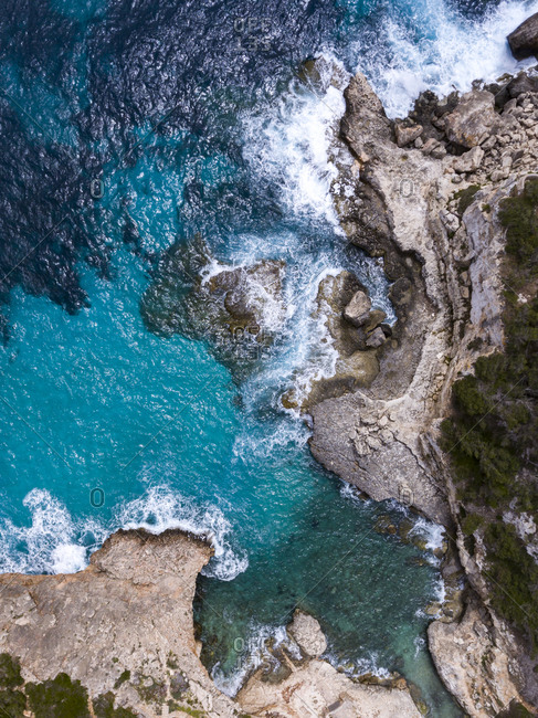 Bird's eye view of rocky coast and blue sea