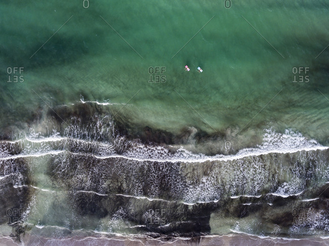 Two women drifting in the sea