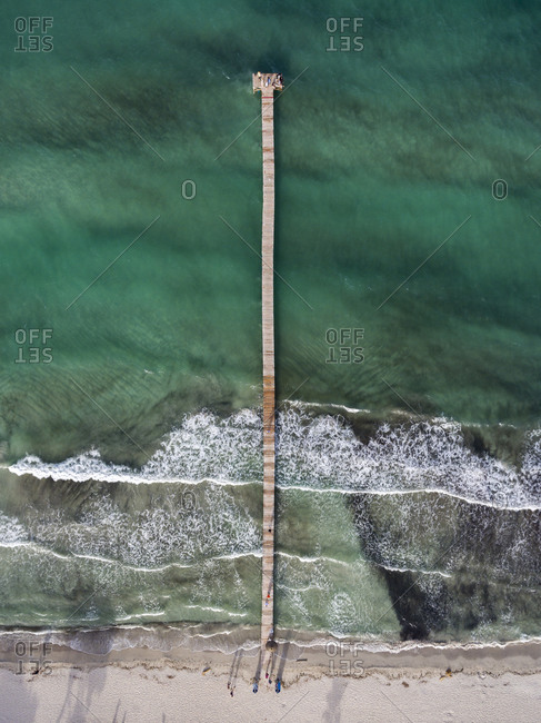 Pier in the sea viewed from above
