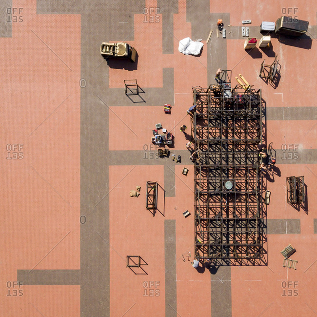 Aerial view of people working to build a structure