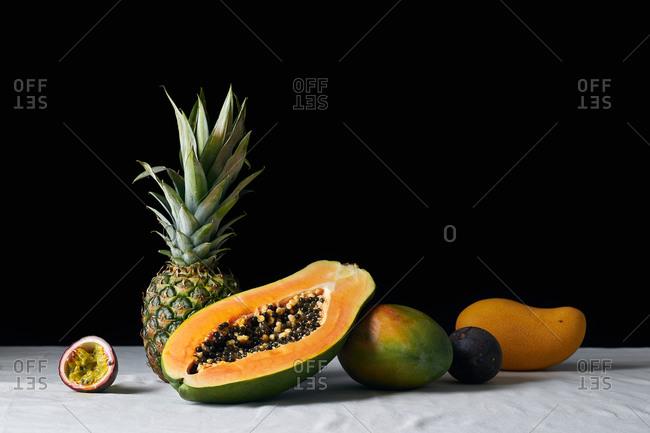 Still life with pineapple, papaya, mango and passion fruit