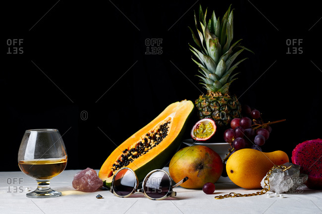 Still life with tropical fruits, gems and various objects