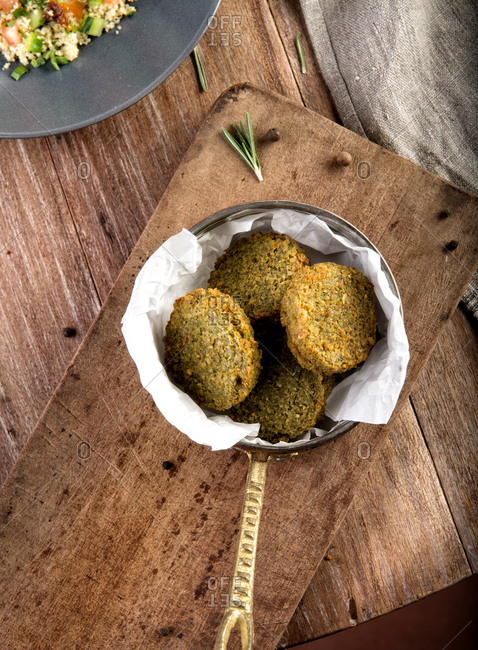 Top view of typical Turkish fried snack falafel made with chickpea served in bowl on rustic wooden table