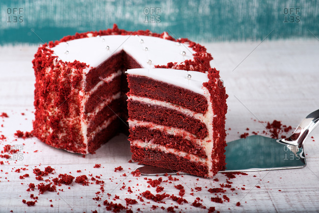 Served delicious red velvet cake on wooden table