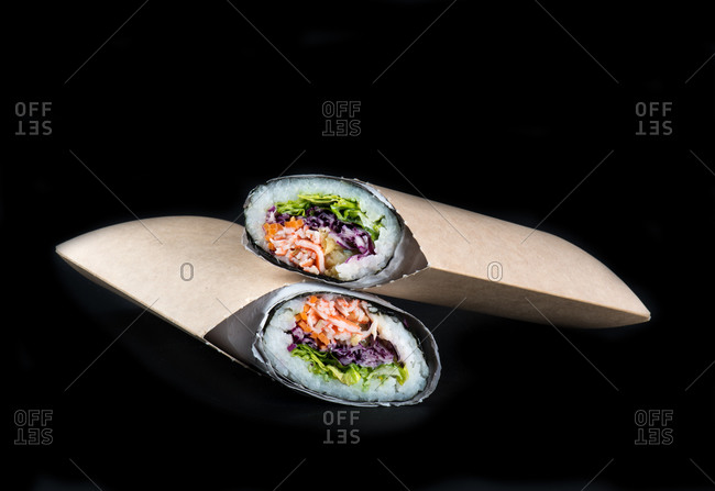 Traditional sushi burritos against black background