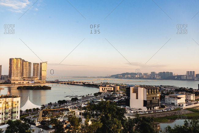- June 2, 2020: Contemporary high rise buildings and infrastructure of Hong Kong with view of channels under sunset sky