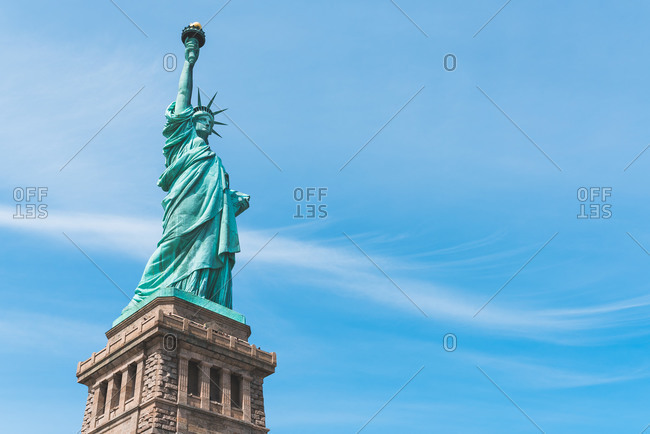 From below of spectacular view of copper Statue of Liberty on Liberty Island on sunny day