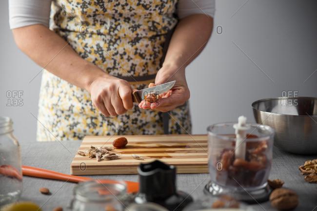 Woman cutting date on a wood board