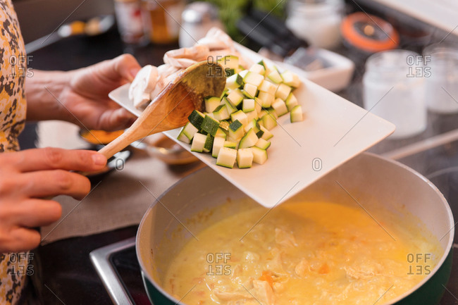 Cooking vegetables in cream on the stove