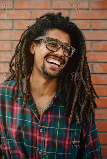 Portrait of a latin man with dreadlocks