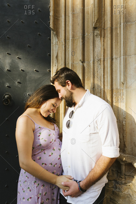Lovely pregnant couple holding hands
