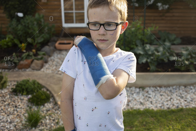 Young boy wearing a blue cast on his arm