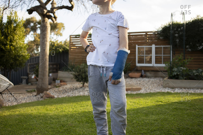 Mid-section of a young boy with a blue cast on his arm