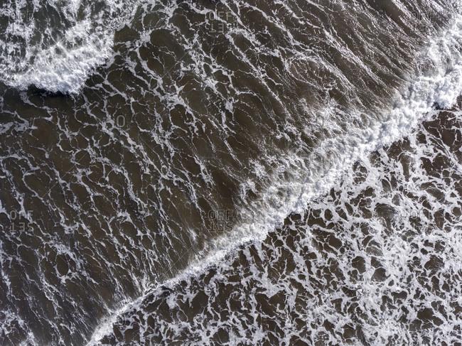 Foamy waves in the Atlantic Ocean from the bird's eye view