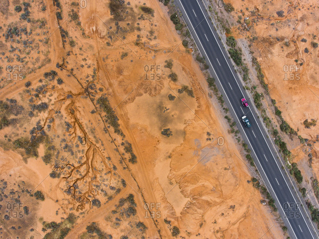 Cars driving on a road in a desert