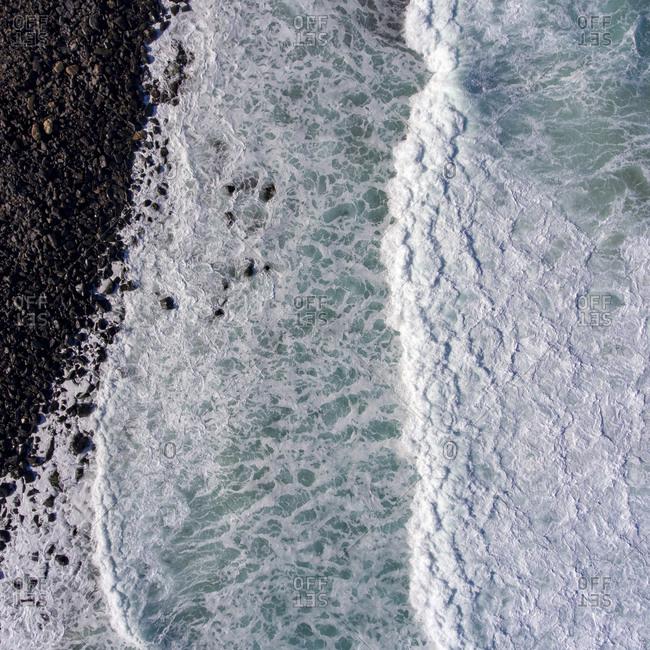 Bird's eye view of a rocky shore on the Atlantic Ocean