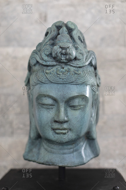 Paradise Valley, Arizona - August 14, 2018: Green carved Buddhist sculpture in a museum