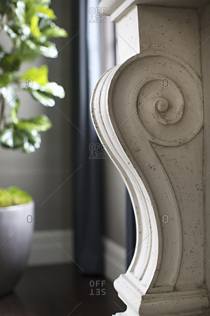 White scroll-like interior architectural detail