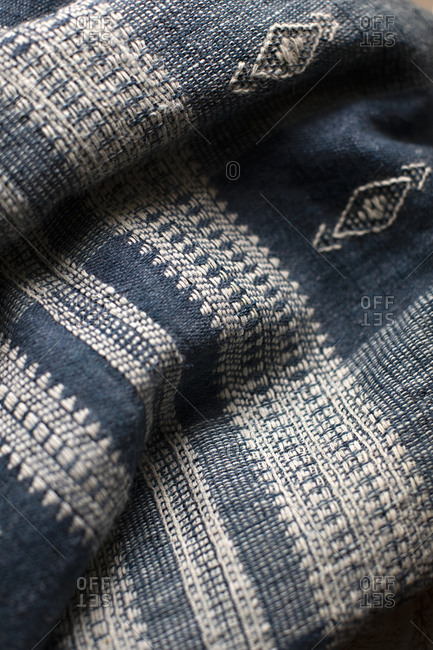 Close up of a blue and white woven textile