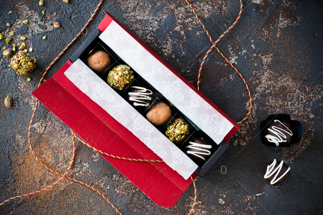 Assorted chocolate truffles in gift box from above