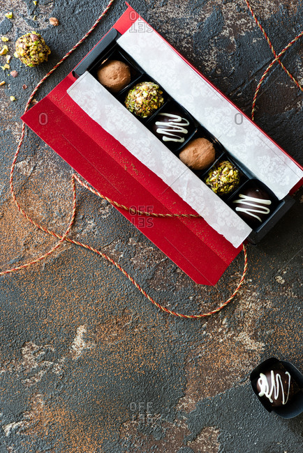 Overhead view of assorted chocolate truffles in gift box from above